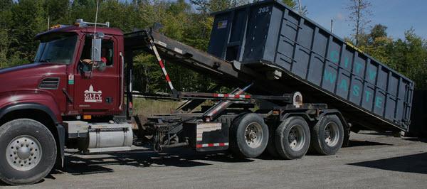 truck_unloading_dumpster